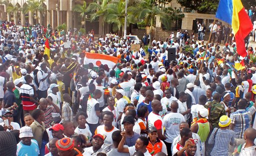 Cameroonian people gather to protest against Islamic extremist attacks in Yaounde, Cameroon, Saturday, Feb. 28, 2015.  Some thousands of Cameroonian youths say they marched through the capital to show support for the military's battle against Nigeria's Islamic extremists in the country's north. (AP Photo/Edwin Kindzeka Moki)