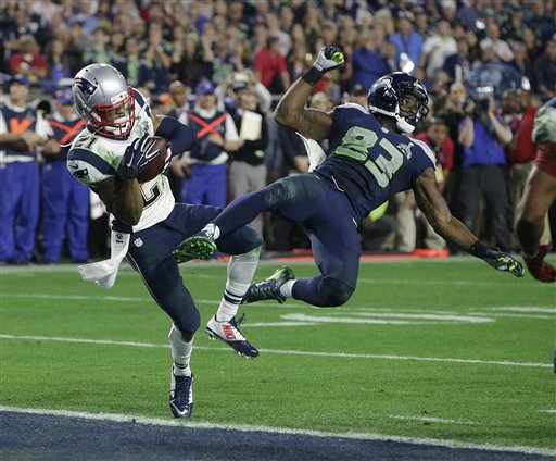 New England Patriots strong safety Malcolm Butler (21) intercepts a pass intended for Seattle Seahawks wide receiver Ricardo Lockette (83) during the second half of NFL Super Bowl XLIX football game Sunday, Feb. 1, 2015, in Glendale, Ariz. (AP Photo/Kathy Willens)
