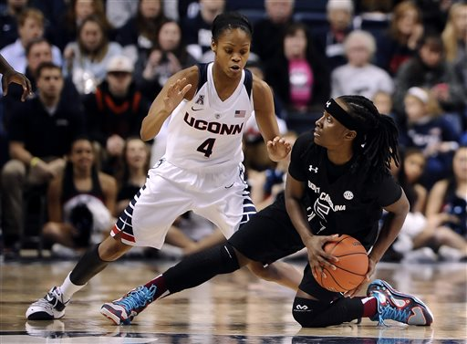 South Carolina''s Khadijah Sessions looks to pass as Connecticut's Moriah Jefferson, left, defends during the first half of an NCAA college basketball game, Monday, Feb. 9, 2015, in Storrs, Conn.  (AP Photo/Jessica Hill)