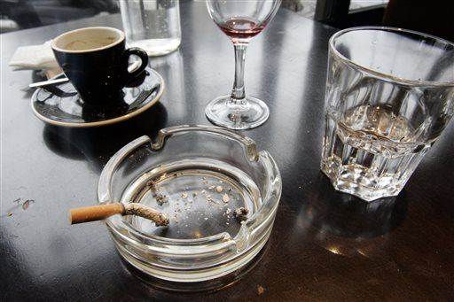 In this Thursday, Dec. 27, 2007 file photo, a cigarette burns out in an ashtray after lunch at a restaurant in Paris. According to a report released on Wednesday, Feb. 4, 2015, for the first time, lung cancer has passed breast cancer as the leading cause of cancer deaths for women in rich countries, according to the American Cancer Society based on new numbers from the International Agency for Research on Cancer. (AP Photo/Francois Mori)