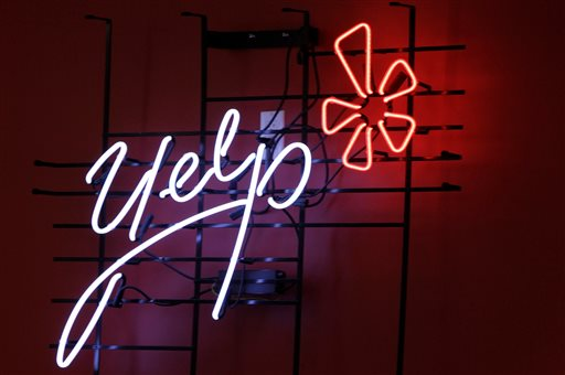 This Oct. 26, 2011 file photo shows the logo of the online reviews website Yelp on a wall at the company's offices in New York. Yelp on Tuesday, Feb. 10, 2015 said it bought online food delivery service Eat24 for $134 million. (AP Photo/Kathy Willens, File)