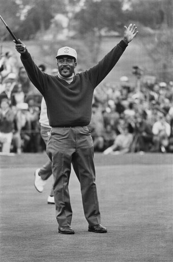 In this Jan. 13, 1969, file photo, Charlie Sifford throws up his arms after he dropped a short par putt on the 18th green to tie Harold Henning at the end of 72 holes in the Los Angeles Open golf tournament. Sifford, who fought the Caucasian-only clause on the PGA Tour and became its first black member has died Monday night Feb. 2, 2015. He was 92. The PGA of America confirmed the death of Sifford, who recently suffered a stroke. No cause of death was given. (AP Photo/File)