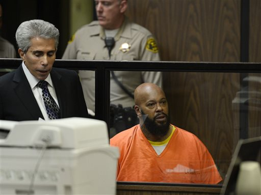Death Row Records founder Suge Knight, right, appears in a court during his arraignment with his attorney, David Kenner, Tuesday, Feb. 3, 2015, in Compton, Calif. Knight, 49, pleaded not guilty to murder, attempted murder and other charges after being accused of striking two men with his truck last week. (AP Photo/Paul Buck, Pool)
