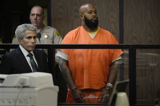 """Marion """"Suge"""" Knight joined by his attorney David Kenner, left, during his arraignment, Tuesday, Feb. 3, 2015 in Compton, Calif.  Knight, 49,  pleaded not guilty on to murder, attempted murder and other charges filed after he struck two men with his truck last week. (AP Photo/Paul Buck, Pool)"""