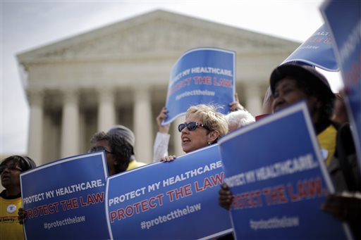 In this March 28, 2012 file photo, supporters of health care reform rally in front of the Supreme Court in Washington on the final day of arguments regarding the health care law signed by President Barack Obama. Nearly five years after Obama signed his health care overhaul into law, the Supreme Court will again get to decide its fate.  (AP Photo/Charles Dharapak, File)
