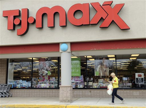 In this Nov. 17, 2009 file photo, a customer walks past a T.J. Maxx store in Boston. TJX Cos., the owner of T.J. Maxx, Marshalls and Home Goods stores, on Wednesday, Feb. 25, 2015 said it will boost pay for U.S. workers to at least $9 per hour. (AP Photo/Lisa Poole, File)