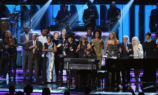 "Stevie Wonder, sitting at piano at bottom center, is joined by guest performers onstage during the finale of ""Stevie Wonder: Songs in the Key of Life - An All-Star Grammy Salute,"" at the Nokia Theatre L.A. Live on Tuesday, Feb. 10, 2015, in Los Angeles. (Photo by Chris Pizzello/Invision/AP)"