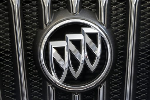 This Feb. 14, 2013 file photo shows a Buick logo on the grill of a 2013 Regal at the Pittsburgh Auto Show, in Pittsburgh. Buick placed seventh on Consumer Reports magazine's list of top auto brands, released Tuesday, Feb. 24, 2015. (AP Photo/Gene J. Puskar, File)