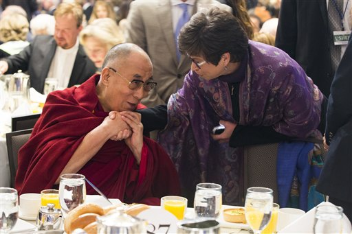 Valerie Jarrett, senior adviser to President Barack Obama, right, talks with the Dalai Lama during the National Prayer Breakfast in Washington, Thursday, Feb. 5, 2015. The annual event brings together U.S. and international leaders from different parties and religions for an hour devoted to faith. (AP Photo/Evan Vucci)