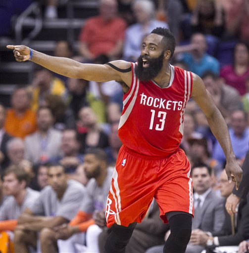 Houston Rockets guard James Harden points after hitting a basket  during the fourth quarter of the NBA basketball game with the Phoenix Suns at the US Airways Center in Phoenix on Tuesday, Feb. 10, 2015. Harden scored with 40 points and the Rockets won the game 127-118. (AP Photo/The Arizona Republic, David Wallace)  MARICOPA COUNTY OUT; MAGS OUT; NO SALES