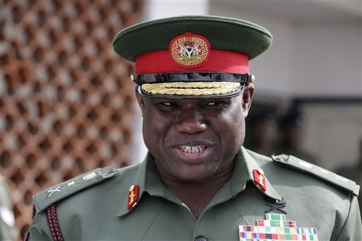 In this photo taken Thursday, Feb. 19, 2015, Nigerian army chief Lt. Gen. Kenneth Minimah, during a function in Lagos, Nigeria.  Nigeria's army chief said that residents displaced from Baga town in the country's northeast should be able to return to vote in March elections after the military reclaimed the town from Islamic extremists. (AP Photo/Sunday Alamba)