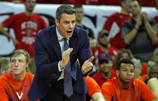 Virginia head coach Tony Bennett instructs from the sidelines during the first half of an NCAA college basketball game against the NC State in Raleigh, N.C., Wednesday, Feb. 11, 2015. (AP Photo/Karl B DeBlaker)