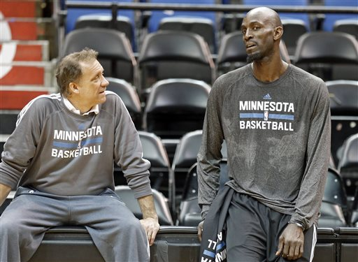 Minnesota Timberwolves' Kevin Garnett, right, talks with head coach Flip Saunders after his first practice on his return to his former team that originally drafted him out of high school, Tuesday, Feb. 24, 2015, in Minneapolis. Garnett waived his no-trade clause with the Brooklyn Nets to return to Minnesota. (AP Photo/Jim Mone)