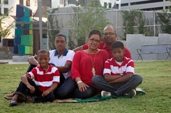 """Shown here with her husband and three sons, Julia Allen said, """"There's nothing like a heart attack to make you change the way you eat and lose a little weight."""" Heart disease is the number one killer of women and is more deadly than all forms of cancer, according to heart association officials. Allen is helping to spread the word about the American Heart Association's National Wear Red Day, which takes place on Friday, Feb. 6. Men and women are encouraged to wear red as a symbol of their support of women's heart health. For more information, visit www.goredforwomen.org.(Courtesy of American Heart Association)"""