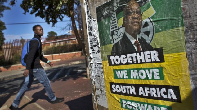 A man walks past an election poster of Jacob Zuma's African National Congress (ANC) party in the Soweto township of Johannesburg, South Africa, on Friday, May 9, 2014. (AP Photo/Ben Curtis)