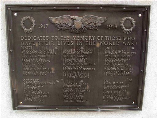 In this photo taken Jan. 22, 2015, shows a plaque honoring World War I soldiers on Greenwood County memorial. The memorial honors its citizens who died in recent wars. The World War I and World War II soldiers are separated into colored and white. Greenwood Mayor Welborn Adams raised $15,000 to put new plaques on the statue, but a state law won't allow him to put them up. (AP Photo/Jeffrey Collins)