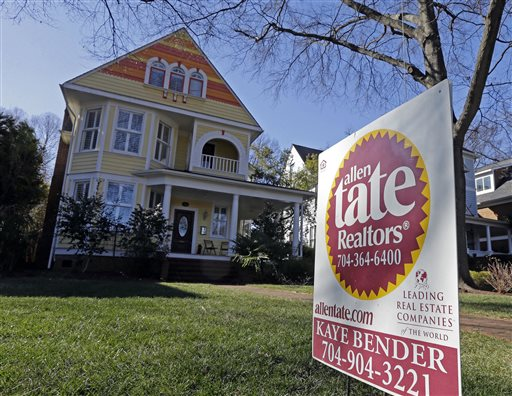 This Jan. 8, 2015 photo shows a home for sale in Charlotte, N.C. The National Association of Realtors reports on sales of existing homes in January on Monday, Feb. 23, 2015. (AP Photo/Chuck Burton)