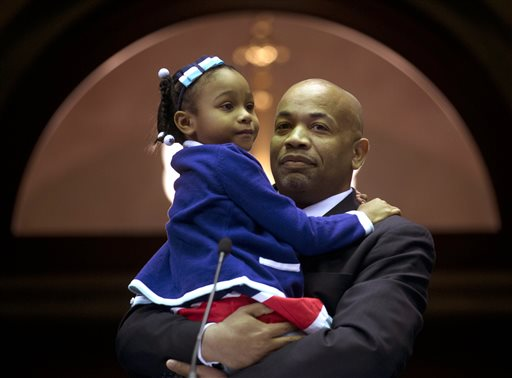 Newly-elected Assembly Speaker Carl Heastie, D-Bronx, holds his daughter Taylor after his election at the Capitol on Tuesday, Feb. 3, 2015, in Albany, N.Y. Heastie is the first African-American speaker, who will lead a chamber that has been rocked by scandal. He succeeds Sheldon Silver, the longtime leader who resigned after being charged with taking nearly $4 million in payoffs and kickbacks. (AP Photo/Mike Groll)