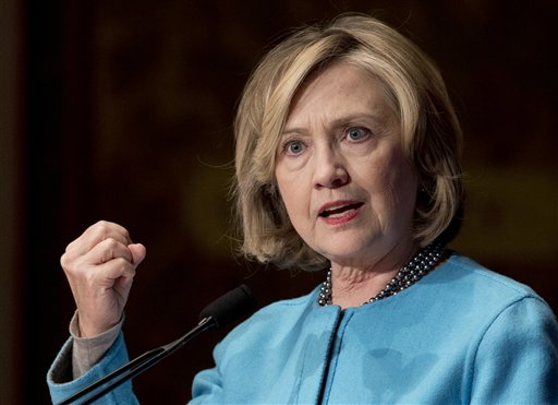In this photo taken Dec. 3, 2014, former Secretary of State Hillary Rodham Clinton speak at Georgetown University in Washington. In 2002, then-Sen. Clinton took a vote in favor of the Iraq war that would come to haunt her presidential prospects. Now, a new generation of senators weighing White House bids _ Marco Rubio, Rand Paul and Ted Cruz _ will have to make a similar choice about President Barack Obama's use of force request. Clinton, too, will face questions about her position on Obama's proposal, but this time has the advantage of avoiding an actual vote on the Senate floor.  (AP Photo/Carolyn Kaster)