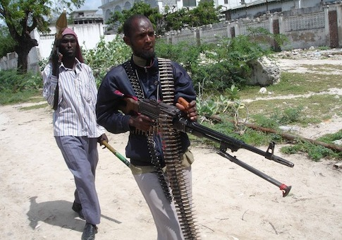 "Hard-line islamist fighters patrol a street in southern Mogadishu, Somalia,  Friday, July 31, 2009. Abu Yahya al-Libi, one of the top Al-Qadah has praised the Somali jihad and gives advice to mujahideen to continue their strikes and be wary of fellow Somalis in a visual speech released on jihadist forums on July 30, 2009.The speech, titled, ""Somalia The Cloud of Summer Dissipated,"" is contained in a 40 minute, 23 second video produced by as-Sahab, the media arm of al-Qaeda. Libi, an official within al-Qaeda's Shariah Committee, has given speeches in the past championing the jihad in Somalia and giving recommendations to Somali mujahideen. (AP Photo/Farah Abdi Warsameh)"