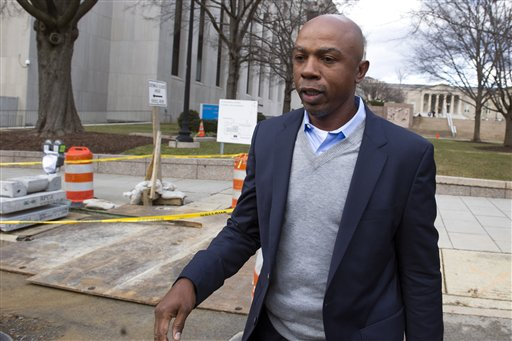 In this Feb. 2, 2015 file photo, basketball analyst Greg Anthony leaves the D.C. Superior Court in Washington. Anthony will have a soliciting prostitution charge dropped if he does 32 hours of community service and stays out of trouble for four months.  Anthony, his attorney and a prosecutor told a judge Wednesday that they had agreed to the deal, called a deferred prosecution agreement. (AP Photo/Cliff Owen, File)