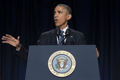 """President Barack Obama speaks during the National Prayer Breakfast in Washington, Thursday, Feb. 5, 2015.   The president condemned those who seek to use religion as a rationale for carrying out violence around the world, declaring Thursday that """"no god condones terror."""" (AP Photo/Evan Vucci)"""