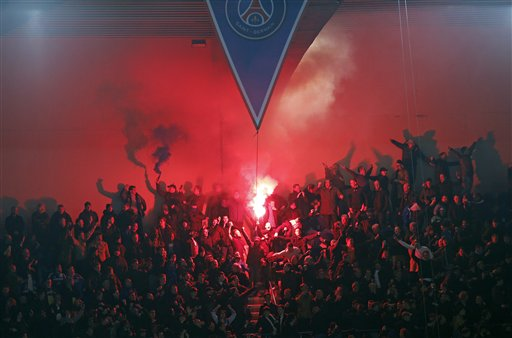 PSG fans light flares during the Champions League round of 16 first leg soccer match between Paris Saint Germain and Chelsea at the Parc des Princes stadium in Paris, France, Tuesday, Feb. 17, 2015. (AP Photo/Christophe Ena)