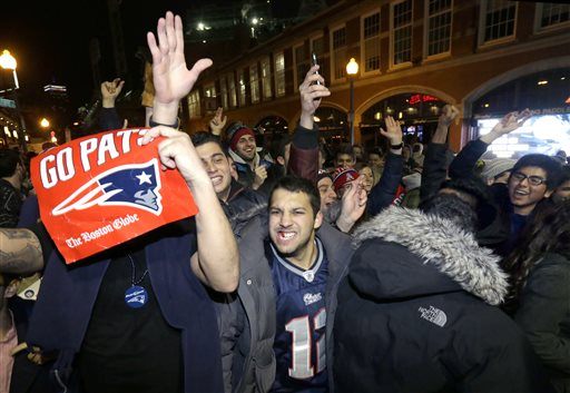 New England Patriots fans celebrate Sunday, Feb. 1, 2015, in Boston, after the Patriots won the NFL Super Bowl XLIX football game against the Seattle Seahawks 28-24 in Glendale, Ariz. (AP Photo/Steven Senne)
