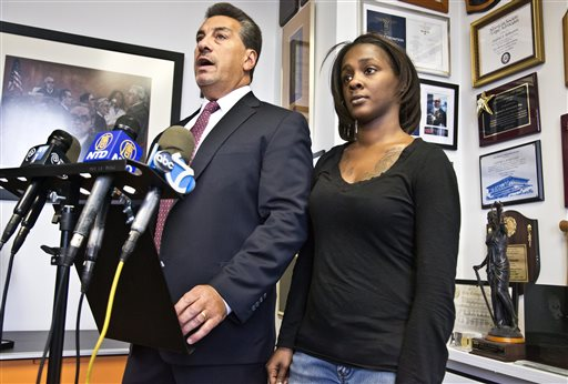 In this Jan. 29, 2015, file photo, Attorney Scott Rynecki, left, and Kimberly Ballinger, the domestic partner of Akai Gurley and mother of his daughter, hold a news conference in New York. Officer Peter Liang will appear in court Wednesday, Feb. 11, 2015, in the November shooting death of Gurley, according to Scott Rynecki, an attorney representing Gurley's family. Liang, who fired into a darkened stairwell at a Brooklyn public housing complex, accidentally killing Gurley who had been waiting for an elevator, has been indicted in his death, a lawyer said Tuesday. (AP Photo/Bebeto Matthews, File)