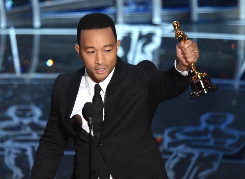 "John Legend accepts the award for best original song in a feature film for ""Glory"" from ""Selma"" at the Oscars on Sunday, Feb. 22, 2015, at the Dolby Theatre in Los Angeles. (Photo by John Shearer/Invision/AP)"
