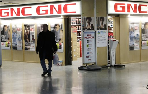 """A man leaves a GNC store, Tuesday, Feb. 3, 2015 in New York. Numerous store brand supplements aren't what their labels claim to be, an ongoing investigation of popular herbal supplements subjected to DNA testing has found, New York Attorney General Eric Schneiderman said Tuesday. GNC, Target, Walmart and Walgreen Co. sold supplements that either couldn't be verified to contain the labeled substance or that contained ingredients not listed on the label, according to Schneiderman's office. """"We stand by the quality, purity and potency of all ingredients listed on the labels of our private label products,"""" said GNC spokeswoman Laura Brophy. (AP Photo/Mark Lennihan)"""
