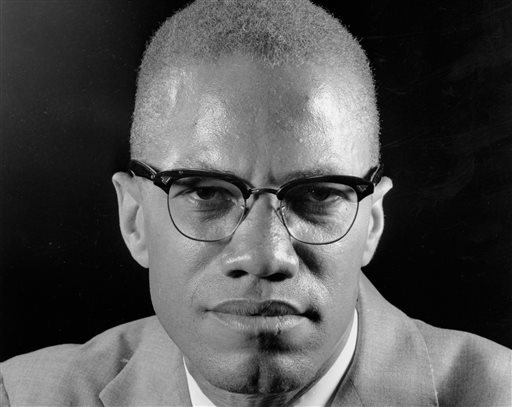 """In this March 5, 1964, file photo, Muslim leader Malcolm X poses during an interview in New York. One of the last major digital holdouts, """"The Autobiography of Malcolm X,"""" should soon be available as an e-book, the attorney for the late activist's estate told The Associated Press, Friday, Feb. 20, 2015. (AP Photo/Eddie Adams, File)"""