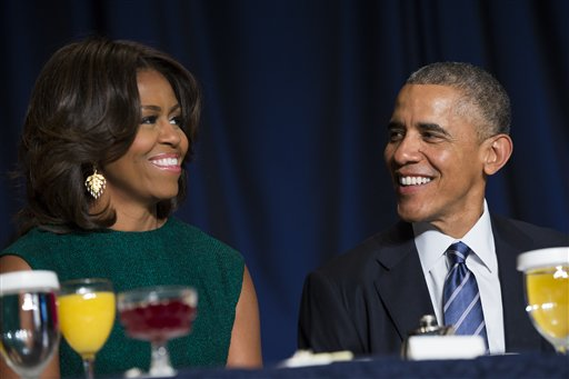 President Barack Obama and first lady Michelle Obama share a laugh during the National Prayer Breakfast in Washington, Thursday, Feb. 5, 2015.  The annual event brings together U.S. and international leaders from different parties and religions for an hour devoted to faith. (AP Photo/Evan Vucci)