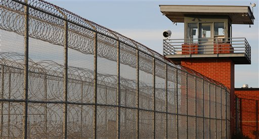 In this photo taken Nov. 13, 2014, a guard tower on the fence line at North Central Unit at Calico Rock, Ark. The unit is where Milton Thomas is currently confined prior to his upcoming trial, expected to be held in March 2015.   He is charged with raping Diana Miller,  71-year-old former nurse and Navy veteran.  Thomas was on parole when he was arrested for raping Miller. (AP Photo/Bill Gorman)