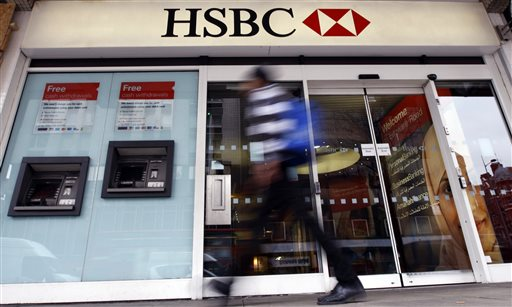 "In this Feb. 27, 2012 file photo, a pedestrian passes a branch of HSBC bank in London. The chair of parliaments Public Accounts Committee says the former chief of HSBC must face serious questions after once-secret papers outlined how the bank helped the wealthy dodge taxes. Margaret Hodge told the BBC on Monday, Feb. 9, 2015 that Stephen Green, HSBC's former CEO, was either ""asleep at the wheel, or he did know and he was therefore involved in dodgy tax practices."" (AP Photo/Kirsty Wigglesworth, File)"
