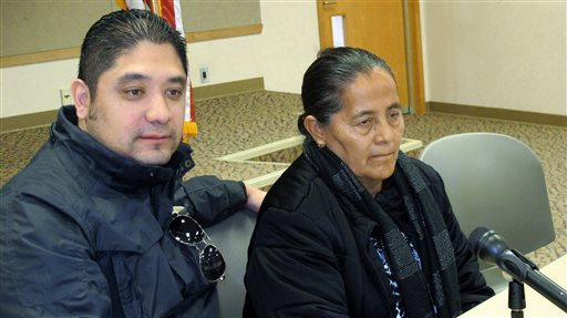Agapita Montes-Rivera, right, the mother of Antonio Zambrano-Montes, who was shot and killed by police in Pasco, Wash., on Feb. 10, 2015, sits with interpreter Fabian Ubay, left, as they talk with the media in Kennewick, Wash., Tuesday, Feb. 24. Agapita Montes-Rivera viewed her son's body for the first time Monday, Feb. 23, and said she hopes for justice in the case that has sparked protests and calls for a federal investigation. The killing of Antonio Zambrano-Montes in Pasco was captured on video by a witness.  (AP Photo/Nicholas K. Geranios)