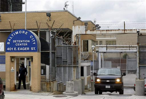 In this June 6, 2013 file photo, an inmate transport van departs from the Baltimore City Detention Center in Baltimore. Federal prosecutors said on Thursday, Feb. 5, 2015, that a federal jury in Baltimore has convicted two of the jail's guards, two inmates and a kitchen worker for their roles in a massive jailhouse drug and cellphone smuggling scheme. The defendants were part of a sweeping 44-person indictment handed down in 2013. (AP Photo/Patrick Semansky, FIle)