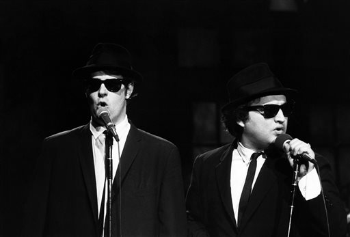 "This Nov. 18, 1978 photo released by NBC shows Dan Aykroyd as Elwood Blues, left, and John Belushi as Jake Blues, performing as the Blues Brothers on ""Saturday Night Live,"" in New York. The long-running sketch comedy series will celebrate their 40th anniversary with a 3-hour special airing Sunday at 8 p.m. EST on NBC. (AP Photo/NBC, Al Levine)"