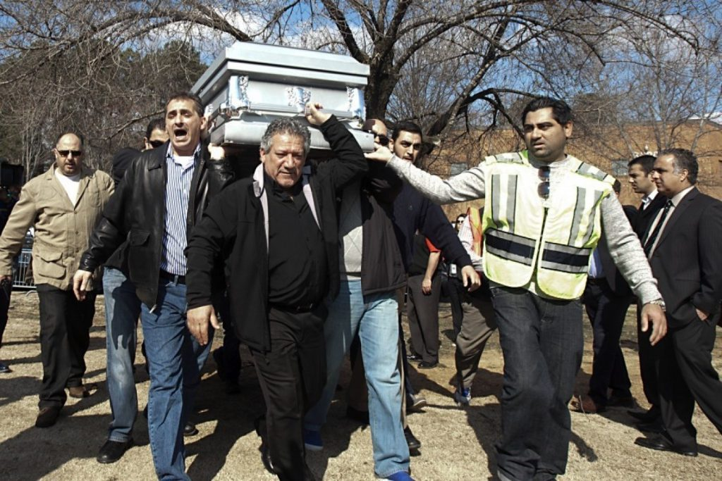 Mourners carry a casket during funeral services for Deah Shaddy Barakat, Yusor Mohammad Abu-Salha and Razan Mohammad Abu-Salh in Raleigh, N.C. (AP Photo/The News & Observer/Corey Lowenstein)