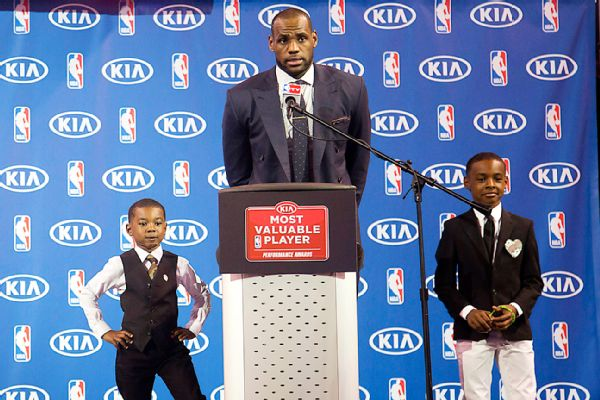 LeBron James (center) with his sons LeBron Jr. (right) and Bryce Maximus (AP Photo/J Pat Carter)