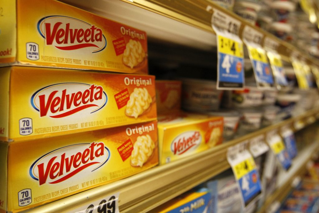 Blocks of Velveeta are on sale in the dairy aisle of the Bi Lo grocery store in the St. Elmo area of Chattanooga, Tenn. on Wednesday, Jan. 8, 2014. (AP Photo/Chattanooga Times Free Press, Doug Strickland)