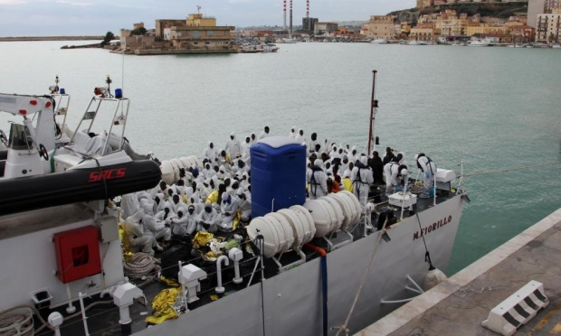 Migrants pictured last month waiting to disembark from an Italian coastguard ship after being rescued. (AP Photo/Francesco Malavolta)