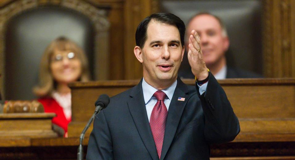 Wisconsin Gov. Scott Walker acknowledges people in the gallery during Governor's State of the State address to a joint session of the Legislature in the Assembly chambers at the state Capitol, Tuesday, Jan. 13, 2015, in Madison, Wis. (AP Photo/Andy Manis)