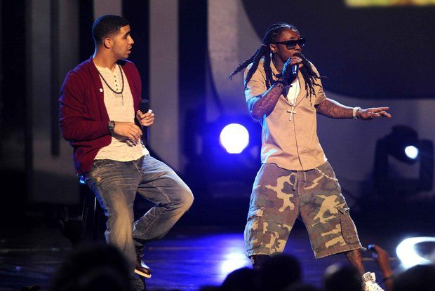 This June 28, 2009 file photo shows Drake, left, and Lil Wayne performing at the 9th Annual BET Awards in Los Angeles. (Chris Pizzello/Invision/AP)