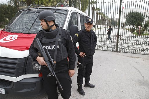 Tunisian police officers guard the entrance of the National Bardo museum in Tunis, Tunisia, Saturday March 21, 2015.  The two extremist gunmen who killed 21 people at a museum in Tunis trained in neighboring Libya before caring out the deadly attack, a top Tunisian security official said. (AP Photo/Michel Euler)