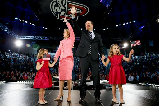 Sen. Ted Cruz, R-Texas, his wife Heidi, and their two daughters Catherine, 4, left, and Caroline, 6, right, wave on stage after he announced his campaign for president, Monday, March 23, 2015 at Liberty University, in Lynchburg, Va. Cruz, who announced his candidacy on twitter in the early morning hours, is the first major candidate to officially enter 2016 race for president. (AP Photo/Andrew Harnik)