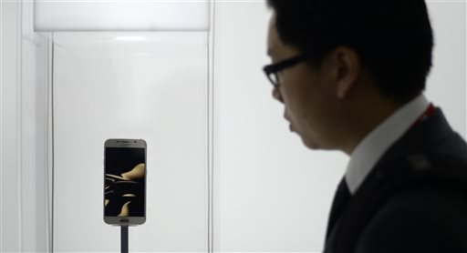 A visitor looks at the new Galaxy S6 during the Mobile World Congress, the world's largest mobile phone trade show in Barcelona, Spain, Monday, March 2, 2015. (AP Photo/Manu Fernandez)