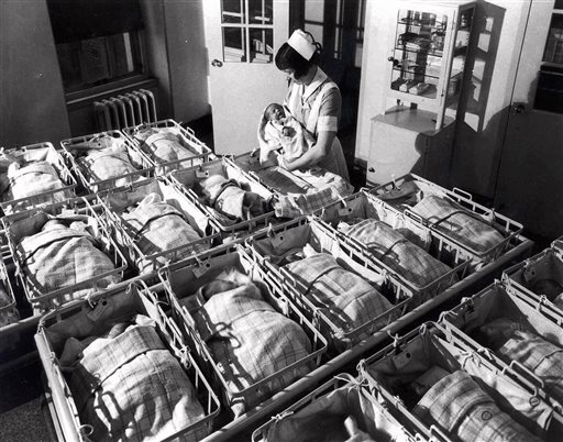 In this 1930, file photo, a nurse holds a baby in the nursery of the Pennsylvania Hospital in Philadelphia. Every year, slightly more boy babies than girl babies are born. But back when sperm meets egg, the two sexes are conceived in equal numbers, according to a new study released on Monday, March 30, 2015. The finding contradicts the idea found in many textbooks and scientific articles that males predominate at conception, researchers said. (AP Photo/File)