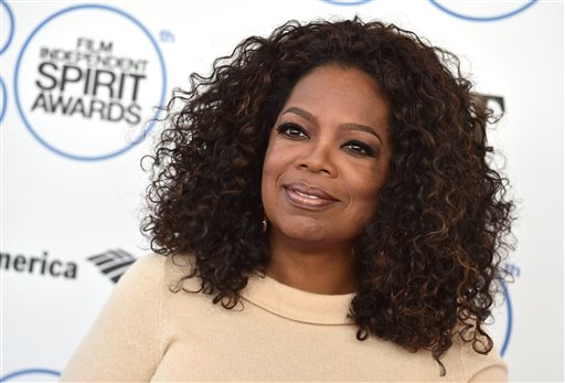 In this Feb. 21, 2015 file photo, Oprah Winfrey arrives at the 30th Film Independent Spirit Awards in Santa Monica, Calif. Leslie Hindman Auctioneers announced Tuesday, March 24, 2015, that Winfrey will sell paintings, furniture, designer clothing and other items from her Chicago residence at auction next month. The auction house says proceeds will benefit the Oprah Winfrey Leadership Academy for Girls in South Africa. (Photo by Jordan Strauss/Invision/AP)