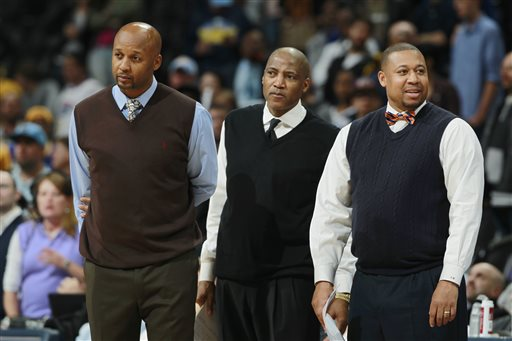 "In this April 16, 2014, file photo, from left, Denver Nuggets head coach Brian Shaw and his assistant coaches Lester Conner and Melvin Hunt look on against the Golden State Warriors in the fourth quarter of the Warriors' 116-112 victory in an NBA basketball game in Denver. The Nuggets have fired coach Brian Shaw after 1½ seasons. General manager Tim Connelly said in a statement Tuesday, March 3, 2015: ""You won't find a better guy than Brian and he is one of the brightest basketball minds I've ever been around. Unfortunately things didn't go as we hoped, but we know with his basketball acumen that he has a very bright future ahead of him."" Assistant coach Melvin Hunt will serve as interim coach. (AP Photo/David Zalubowski, File)"